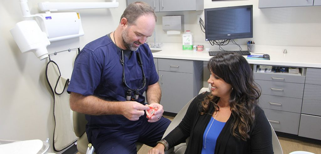 Dr. Clayton working with a patient